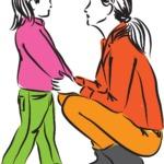 parent kneeling in front of child