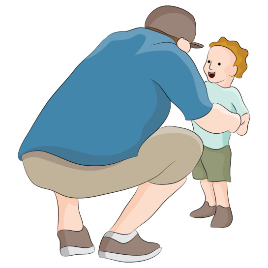 man crouching down to talk to small child